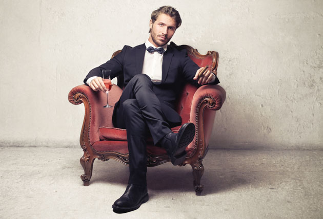 DGXGK6 Gentleman sitting on a vintage armchair
